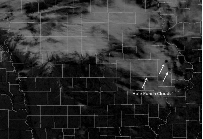 hole punch clouds - fallstreak holes - on satellite image iowa december 25 2014, hole punch cloud rainbow iowa christmas 2014 december 25 2014, Rainbow in hole punch cloud over Iowa on Christmas day 2014, hole punch cloud rainbow iowa christmas 2014, hole punch cloud iowa christmas 2014, Fallstreak hole iowa christmas 2014, strange cloud over iowa christmas 2014, strange cloud phenomenon pict: fallstreak cloud iowa, hole punch cloud iowas december 25 2014, Plenty of fallstreak holes also known as hole punch cloud appeared in the sky over Iowa on Christmas, December 25, 2014.