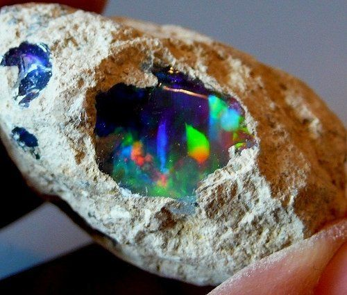 inside a raw opal, colorful raw opals