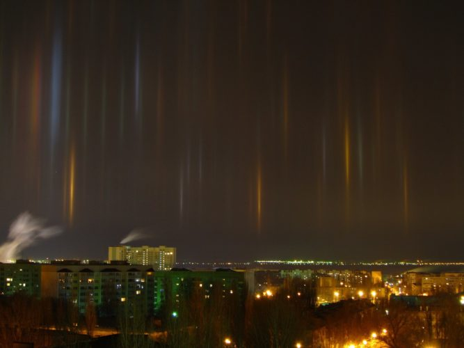 Angels are descending to earth through eerie light pillars ...