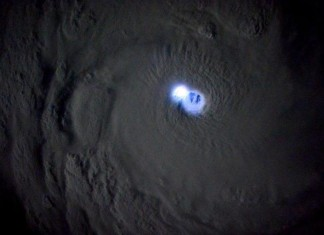 lightning Tropical Cyclone Bansi photo, lightning bansi picts, iss photo lightning bansi, lightning lighting up the eye of Tropical Cyclone Bansi in the Indian Ocean, look into the eye of the cyclone, cyclone bansi pictures, best aerial photo bansi cyclone, best pictures of cyclone bansi