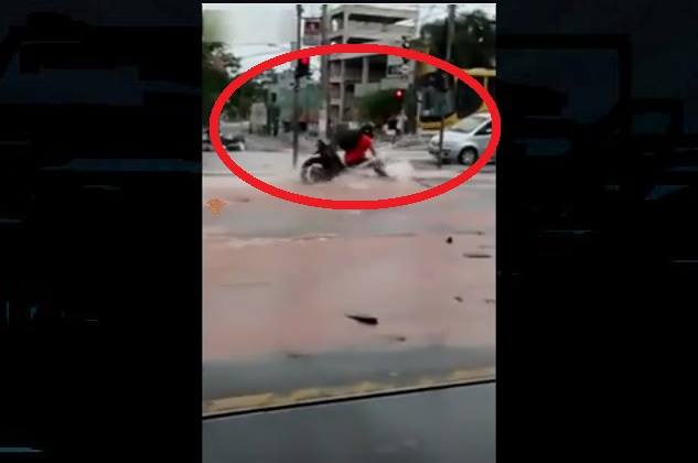 motorcyclist sinkhole video, motorcyclist sinkhole rio, rio motorbike sinkhole, biker swallowed by sinkhole in rio, video biker sinkhole rio, biker swallowed by sinkhole in rio, biker sinkhole brazil video