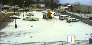 sinkhole swallows snow plow, snow plow falls in sinkhole, snow plow sinkhole, sinkhole snow plow video, just a snow plow swallowed by a sinkhole