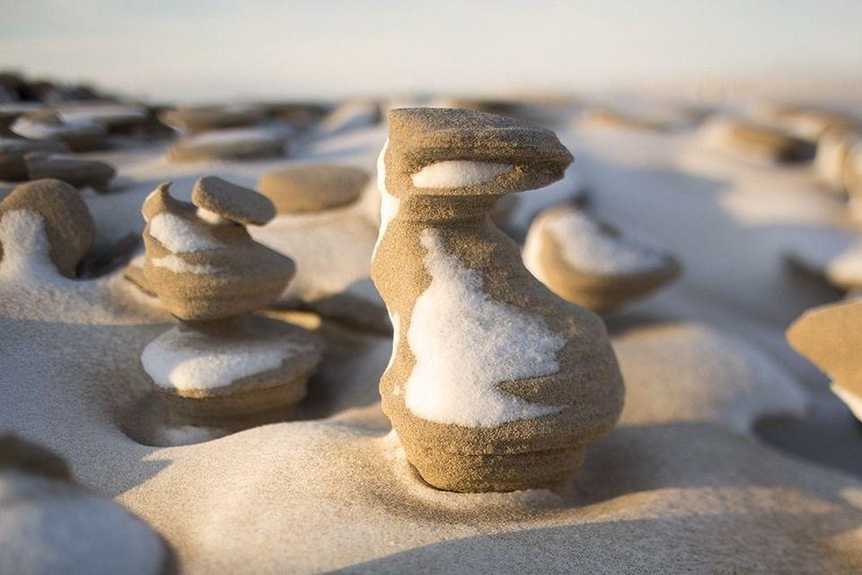hoodoos, hoodoo, frozen sand formation, frozen sand sculptures, frozen sand sculptures lake michigan, hoodoos lake michigan 2015, strange frozen sand sculpture found on lake michigan shore, hodoos lake michigan pictures