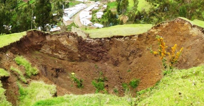 giant sinkhole peru, giant sinkhole peru swallows village, village swallowed by giant sinkhole in peru, huge sinkhole in peru may swallow a village, sinkhole may swollow village in Peru.
