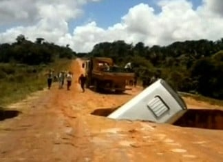 bus crater brazil, Bus sucked into sinkhole and swept away by river video, video of Bus sucked into sinkhole and swept away by river, bus crater brazil video, video of bus swallowed by crater in brazil, crater swallows bus in brazilian rain forest,