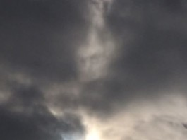 mystery face cloud, face in cloud during solar eclipse march 2015, face in cloud video, march 2015 solar eclipse face in cloud, face in clouds video, face in clouds photo, Solar Eclipse: Woman captures mystery face in cloud after taking picture of phenomenon