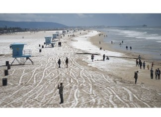hail huntington beach march 2015 photo and video, snow huntington beach march 2015, hailstorm huntington beach march 2015, snow in huntington beach march 2015 video, snow orange county march 2015, A chilly storm blew in hail pellets near the Huntington Beach Pier.