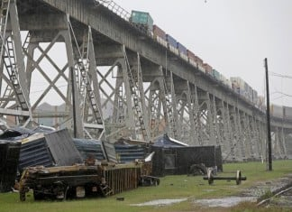 Strong winds blow train cars off bridge louisiana, Strong winds blow train cars off bridge video, Strong winds blow train cars off bridge video and photo, Strong winds knocked over some train cars in Jefferson Parish, train derailment jefferson parish, strong winds knock off train from suspended tracks, louisiana train knocked down track,