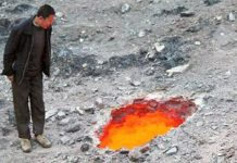 Large crater starts spewing fire and extreme heat in China, Large crater starts spewing fire and extreme heat in China video, Large crater starts spewing fire and extreme heat in China picture