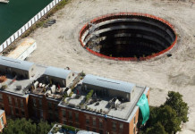 deep hole chicago spire, spire giant hole chicago,