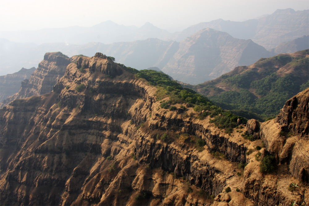 Deccan Traps volcanism dinosaur extinction, asteroid dinosaur extinction, dinosaur extinction theories, dinosaur extinction theory, volcanism and asteroid dinosaur extinction, Photograph of part of the main stack of 66 million year old Deccan Traps lava flows near the city of Mahabaleshwar, India. The entire volume of the Deccan Traps could have covered an area as large as the state of California in a mile deep pile of lava flows.(Mark Richards photo)