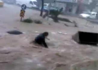 izmir flooding, izmir flooding 2015, izmir flooding may 2015, izmir flooding may 2015 video, woman dragged by waters during izmir floods may 2015, izmir floods may 2015 video, izmir flooding many 2015