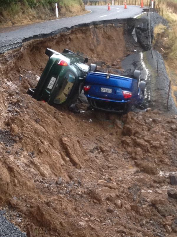 sinkhole Dunedin NZ june 2015, sinkhole Dunedin NZ june 2015, two cars swallowed by sinkhole in dunedin, dunedin sinkhole swallows two cars june 2015, deluge creates sinkhole in dunedin nz june 2015, 2 cars swallowed by sinkhole dunedin june 2015, The two cars swallowed by the giant sinkhole in Dunedin, New Zealand on June 3 2015., A close-up picture of the two cars at the bottom of the sinkhole. Photo: Mark Walton
