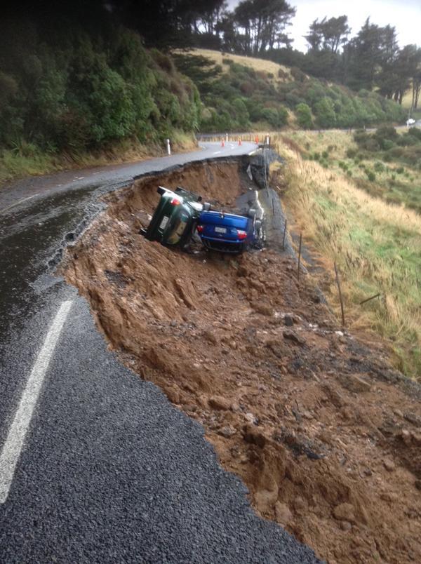 sinkhole Dunedin NZ june 2015, two cars swallowed by sinkhole in dunedin, dunedin sinkhole swallows two cars june 2015, deluge creates sinkhole in dunedin nz june 2015, 2 cars swallowed by sinkhole dunedin june 2015, The two cars swallowed by the giant sinkhole in Dunedin, New Zealand on June 3 2015.