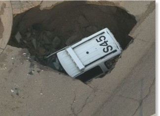 Colorado sinkhole swallows police car, Police SUV swallowed by sinkhole in Colorado, sinkhole colorado police car june 2015, sinkhole police suv colorado,