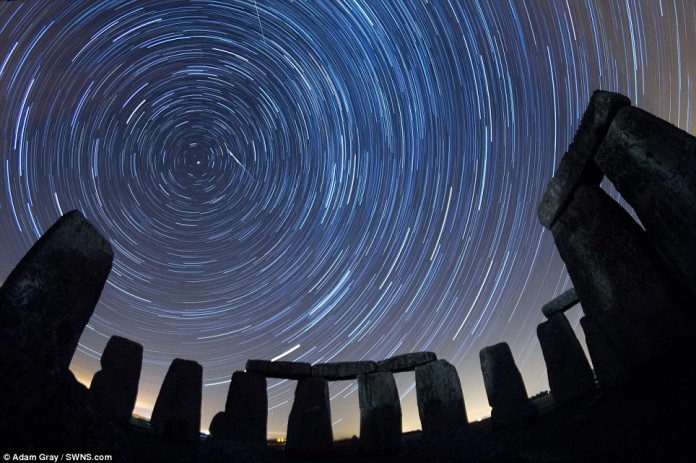 Perseid meteor shower, perseids, perseids picture, perseid meteor shower photo, A composite photograph made from several long exposures of the Perseid meteor shower reaching its peak at the megalithic circle at Stonehenge in Salisbury Plain