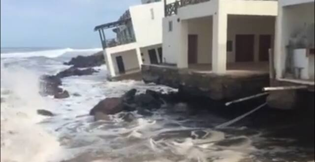 rising sea mexico, sea swallows building in mexico, house swallowed by rising sea mexico, mexico rising sea swallowed, high sea swallows house