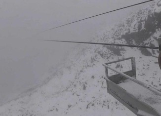 snowfall montana idaho Wyoming july 2015, snow storm rockies july 2015, snowfall northern rockies july 27 2015, Snow in July at Big Sky resort near the top of Lone Peak, Montana., snow montana july 2015, snow idaho july 2015, snow wyoming july 2015