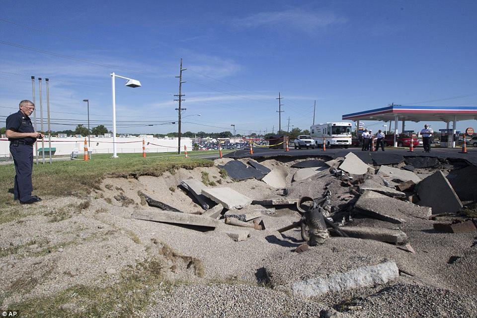lightning gas station fairfield, lightning hit gas station fairfield, giant crater after lightning hits gas station in Ohio, bolt hits gas station ohio, fairfield gas station hit by lightning bolt