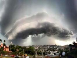 cloud brazil, insane cloud, amazing cloud formation terrifying cloud formation, terrifying cloud, strange cloud, haarp cloud, weird haarp cloud, Is it an eye in the sky? Apocalyptical cloud over Río Grande Do Sul, Brazil on October 14 2015.