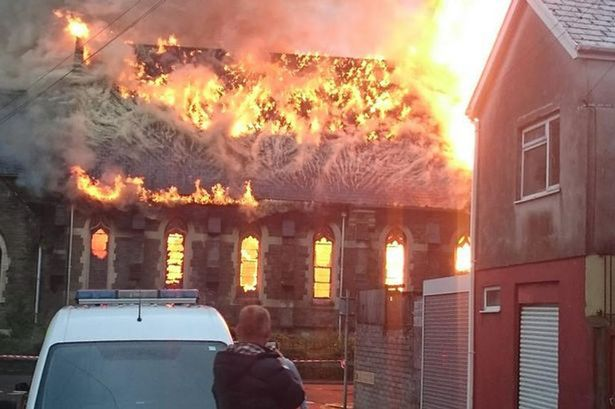 face church fire, Can you see the faces in this church inferno?, burning church face, face during church fire, face observed in flaming church, face church blaze, pareidolia, pareidolia example