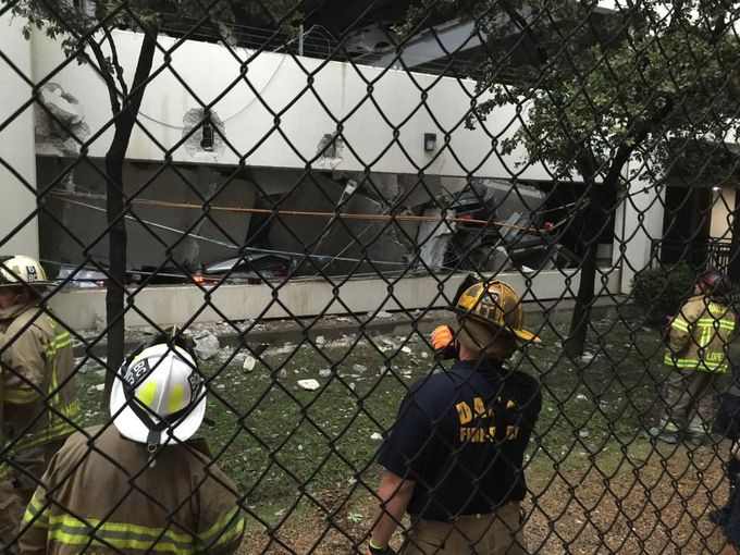 parking garage collapse dallas, parking garage collapses dallas, parking collapse dallas, The view from the hole. Several floors of a parking garage fell into the Earth in Dallas, Part of parking garage collapses in Turtle Creek, parking garage collapse dallas video, parking garage collapse dallas video, my car got just swallowed by my garage on Turtle Creek in Dallas