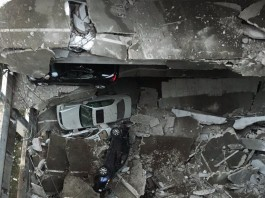 parking garage collapse dallas, parking garage collapses dallas, parking collapse dallas, The view from the hole. Several floors of a parking garage fell into the Earth in Dallas, Part of parking garage collapses in Turtle Creek, parking garage collapse dallas video, parking garage collapse dallas video