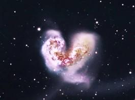 antennae galaxies heart universe, heart-shaped galaxy, galactical collision, galactical collision antennae galaxies, antennae galaxies collision, heart shaped galaxies, heart in universe, largest heart in universe, Roberto Antezana captured this awesome picture of the largest heart galaxies in the whole universe on November 11 2015 at 11:11