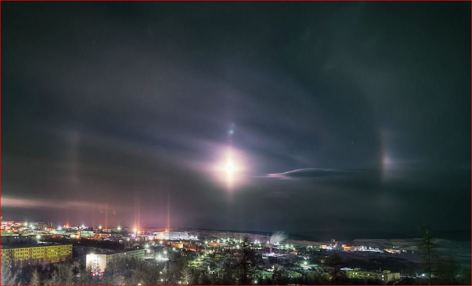 moondog and light pillars, moondogs, light pillars, moondogs picture, light pillars picture, Magical sky in northern Russia as moondogs and light pillars appear light up the night sky, Do you see the faint halo around the moon? And the moondogs? and the light pillars?