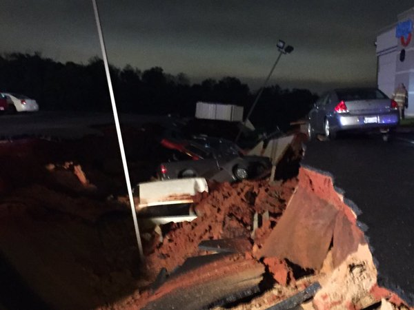 sinkhole swallows 15 cars mississippi, sinkhole swallows 15 cars meridian mississippi, sinkhole swallows 15 cars meridian mississippi pictures, sinkhole swallows 15 cars meridian mississippi videos, giant sinkhole mississippi november 7 2015, mysterious sinkhole meridian mississippi november 7 2015, meridian mississippi sinkhole, sinkhole meridian mississippi nov 2015, A view into the giant sinkhole that opened up in Meridian Mississippi on November 7 2015