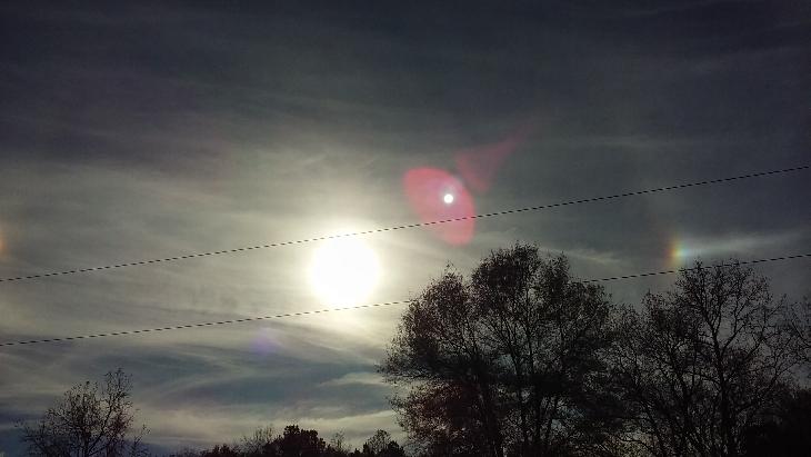sun dogs, sun dogs georgia, sundogs georgia november 2015, Did you also observe these sundogs in the sky of Georgia on November 24 2015? Photo: Larry Martin, Sun dog, sundogs, mock suns, phantom suns, parhelia, And what is this fourth sun appearing behind the sun? Planet X?