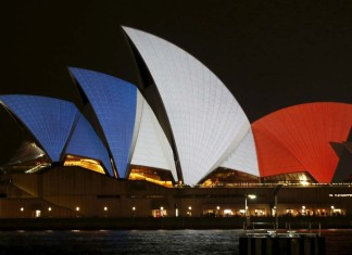 paris terror attacks pictures, paris terror attacks solidarity, paris terror attacks solidarity around the world, paris terror attacks landmarks solidarity pictures, terror attack paris november 2015, lights of solidarity paris terror attacks, The lights of the Eiffel Tower are off following the terror attacks., Paris terror attacks: World landmarks light up in show of unity with France following deadly atrocities, Sydney Opera House lit up in blue, white and red as world cities adopt the Tricolore
