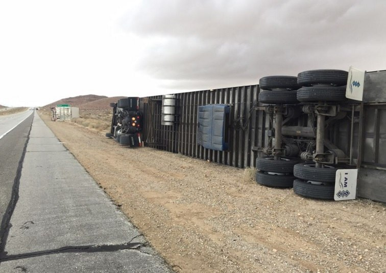 mojave desert wind truck, strong winds mojave desert california, mojave desert wind overturns truck, high winds overturn truck in mojave desert california, WINDS TOPPLE SEVERAL BIG RIGS ON 14 FREEWAY IN MOJAVE DESERT, trucks overturned mojave desert, mojave desert truck overturn, mojave desert high winds picture, mojave desert wind truck overturned photo