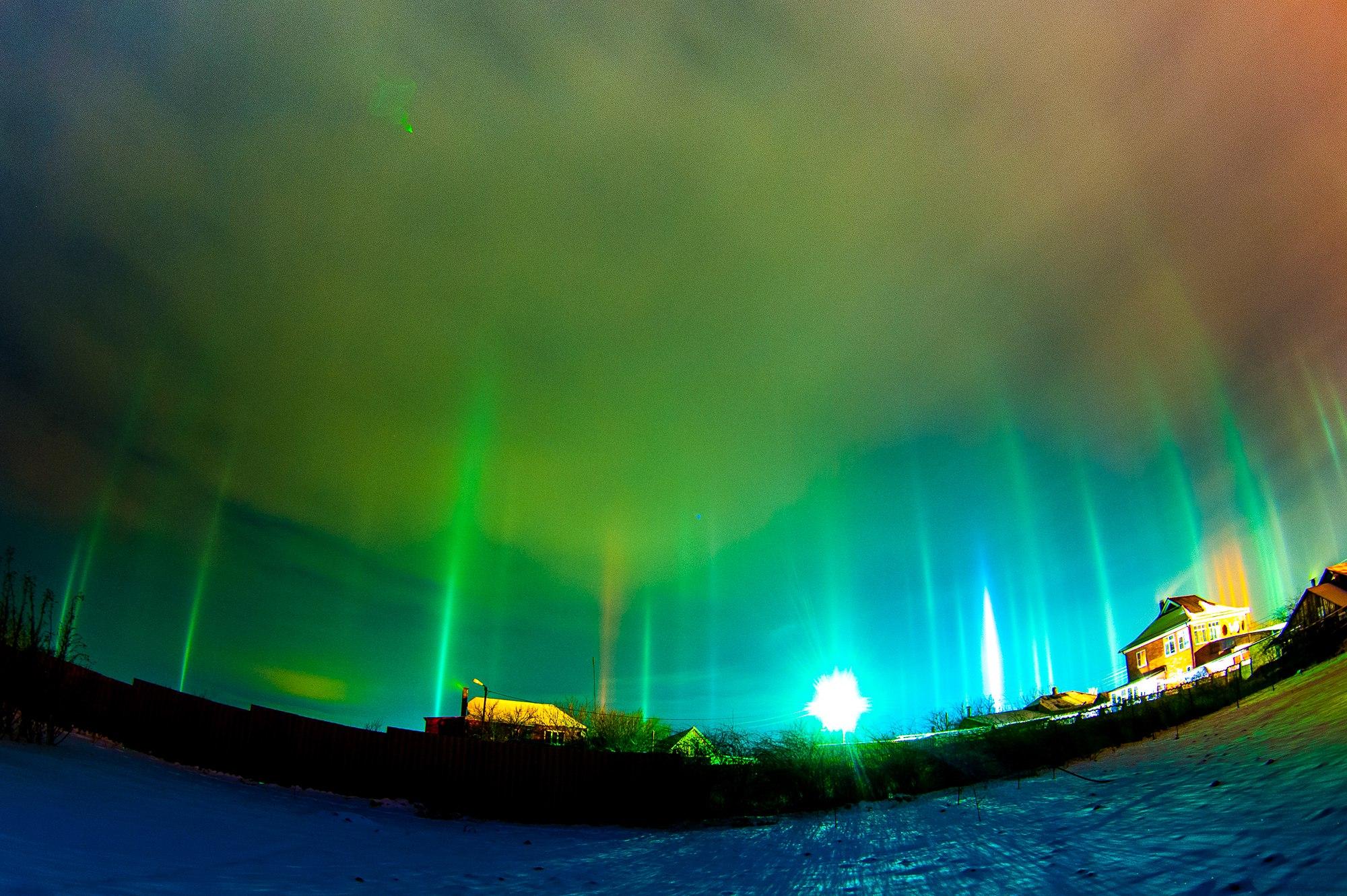 Glowing interdimensional portals open up in the sky of ...  Glowing interdi...