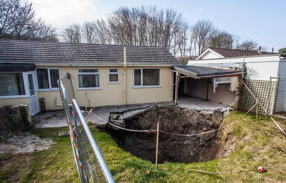 abyss sinkhole, Mineshaft in Scorrier near Redruth Cornwall, abyssal sinkhole in Scorrier near Redruth Cornwall, deep sinkhole in Scorrier near Redruth Cornwall, Mineshaft collapses in Scorrier near Redruth Cornwall