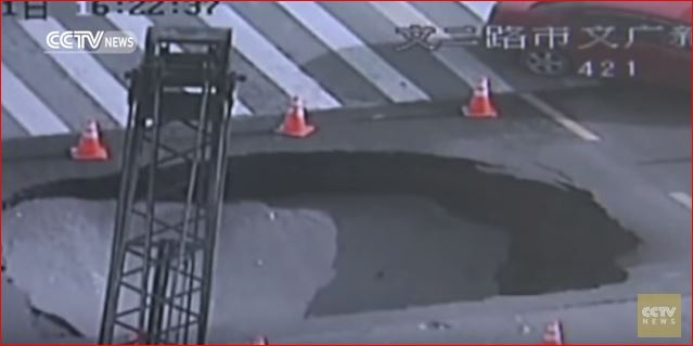 road collapse giant sinkhole china cctv video, sinkhole cctv video, sinkhole video china, sinkhole forms in front of cameras in china, china sinkhole april 2016 video