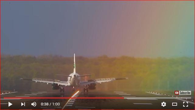 plane landing rainbow germany, germania airplane landing in rainbow, rainbow plane video, plane landing in rainbow video