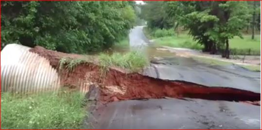 road cracks texas floods, road collapse floods texas, road cracks collapse texas floods