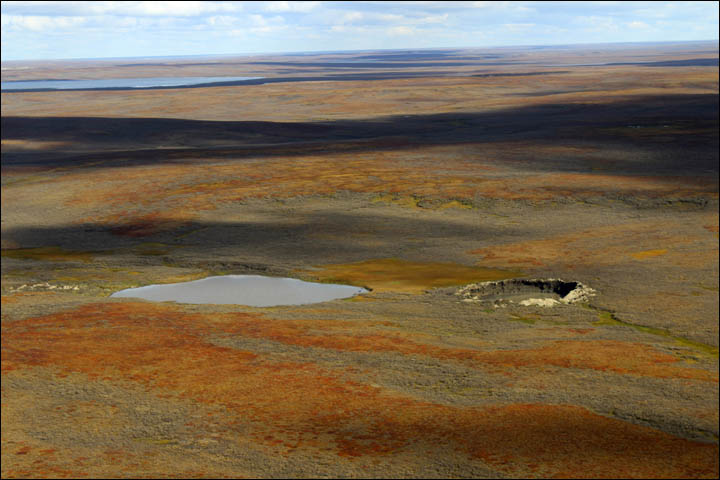 big bang form mysterious crater siberia, big bang crater siberia loud boom, big bang theory mysterious crater siberia, loud boom mysterious crater siberia formation, big bang and sky glow create siberian crater, Siberia's mystery end of the world crater formed after massive explosion heard 100km away, Enormous 'big bang' that caused a 'glow in the sky' created 230ft mystery crater, Big bang formed crater causing 'glow in sky': explosion was heard 100 km away