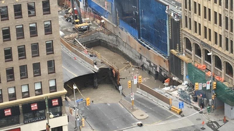 Enormous sinkhole devours Rideau Street in downtown Ottawa videos ...