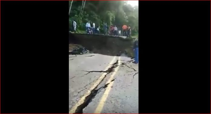 road collapse colombia, 200 meters of road swallowed by sinkhole colombia, colombia road collapse, road collapse colombia july 2016 video, sinkhole swallows road colombia july 2016 video, sinkhole swallows road colombia video, giant road collapse colombia video, road collapse video