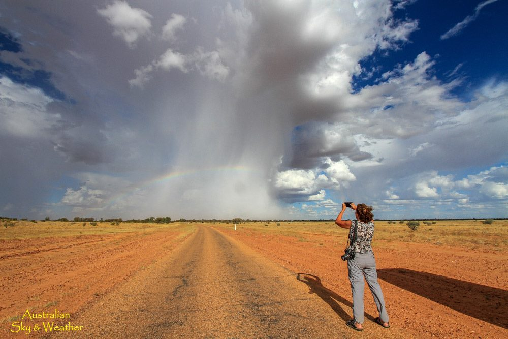 local shower rainbow queensland australia, local shower rainbow queensland australia december 2016, local shower rainbow queensland australia pictures, surreal image of local shower and rainbow in desertic australia