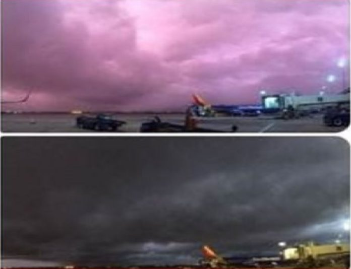 purple sky houston, magenta sky houston, pink sky houston, Purple rain: Thunderstorms turn Houston sky to vivid shades pink and purple