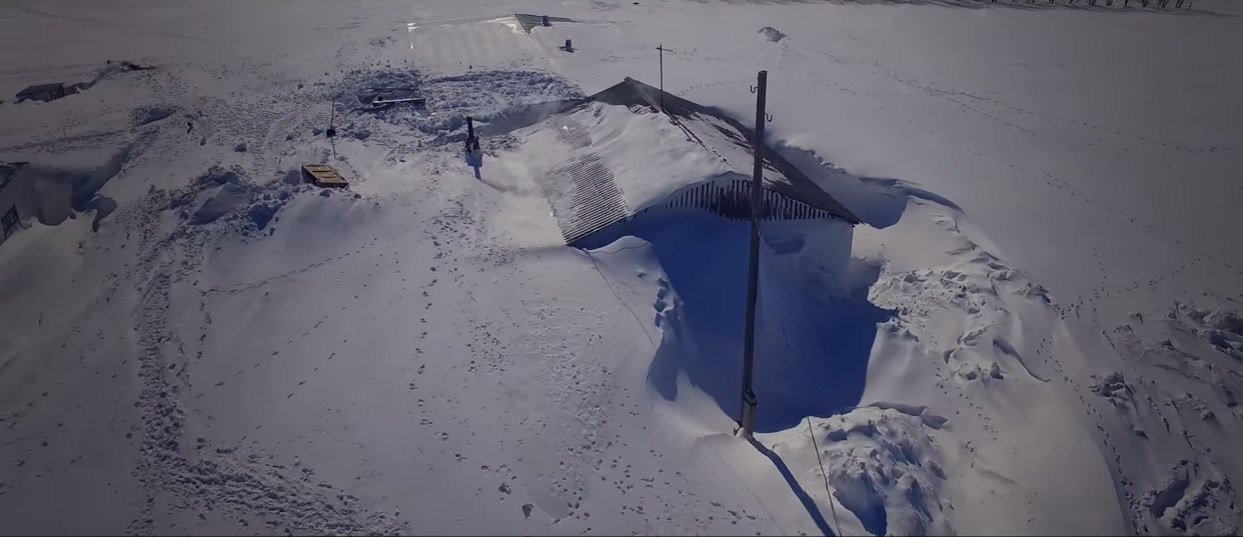 snow blizzard Kazakhstan, snow blizzard Kazakhstan february 2017, snow covers houses in Kazakhstan, people build snow tunnels to get out of their homes in Kazakhstan, huge amount of snow Kazakhstan video and pictures
