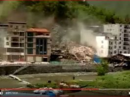landslide destroys building china, china landslide, seven-story residential building collapsed in the landslide