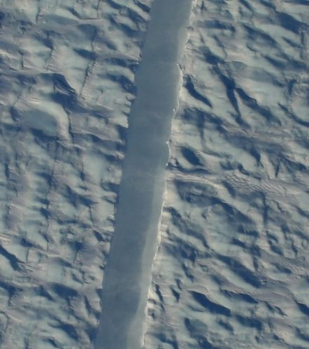 Scientists just found a strange and worrying crack in one of Greenland biggest glaciers, NASA just snapped the first photos of a mysterious crack in one of Greenland largest glaciers, NASA takes photos of crack in Greenland glacier, new giant crack greenland glacier, Preliminary DMS image of the new rift in Greenland's Petermann Glacier, directly beneath the NASA Operation IceBridge aircraft. (Gary Hoffmann/NASA).