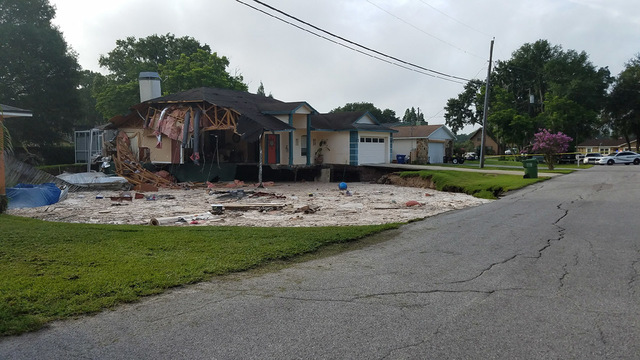 giant sinkhole swallows two homes in florida, giant sinkhole swallows two homes in florida july 2017, giant sinkhole swallows two homes in florida pictures, giant sinkhole swallows two homes in florida video, giant sinkhole swallows two homes in florida july 2017 video and pictures