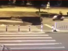 scooter sinkhole video, scooter sinkhole video china, scooter swallowed by sinkhole video