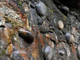 egg laying cliff china, stone eggs china, msterious egg mountain china, mountain las eggs china