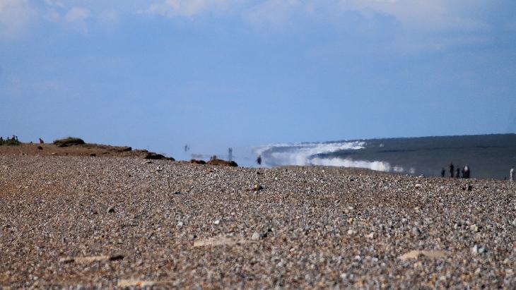 giant wave crash uk beach mirage, mirage uk beach, mirage tsunami wave uk beach, giant wave crashes onto uk wave mirage, mirage tsunami uk beach